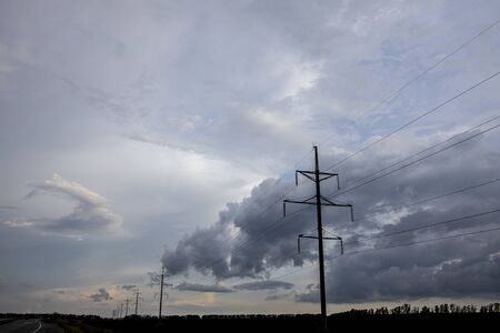 power lines in the background of the terrible pre-storm sky.