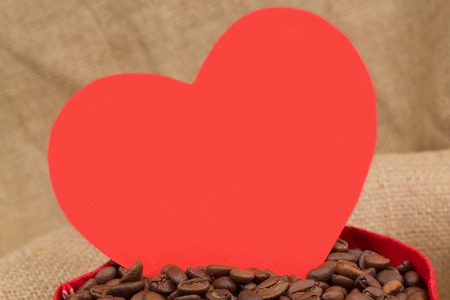 st  valentin: Red paper heart in the sac with coffe beans