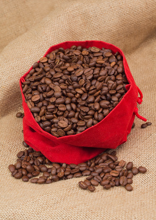 Red velvet sac with coffee beans photo