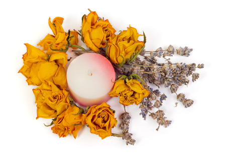 perfumed candle: Spa Accessories, yellow dried roses with lavender and candle isolated on white