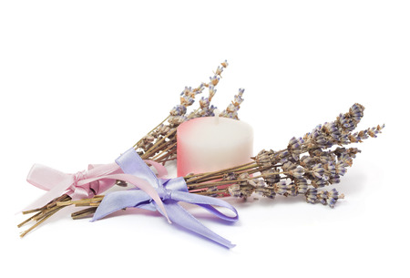 perfumed candle: Spa Accessories, two bunches of lavender with ribbon and a candle isolated on white Stock Photo