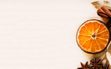 Anise, cinnamon, orange and dry leaves ingredients for preparation mulled wine, closeup on wooden background.Top view flat lay copy space. 写真素材