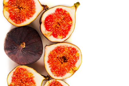 Fresh figs. Fruit with half isolated on white background. With clipping path. View from above. Copy space for text.