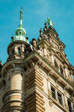 Hamburg, Germany - April 7, 2018: Exterior view of the town hall of Hamburg on April 7, 2018. The town hall (German The Hamburg Rathaus) was built 1897 and is the seat of the government of Hamburg.