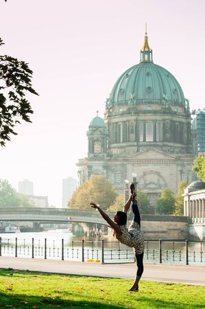 Berlin, Germany - 06.09.18. Berlin Cathedral (Berliner Dom) and Fridrich bridge (in German Friedrichsbrucke) located in the area of museum's island with black dancing woman in front of it.
