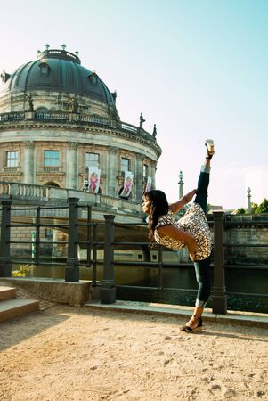 Berlin, Germany - 06.09.18. The view of Bode Museum and Nord Monbijou bridge with black dancing woman in front of it.