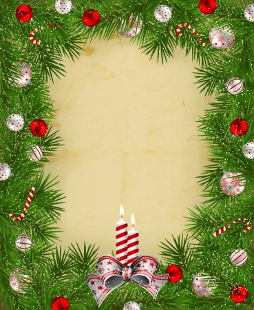 Frame of fir branches decorated with baubles and candles