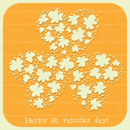 St. Patrick day card, many small paper clovers forming one big three leaf clover on orange background with wooden texture Vector