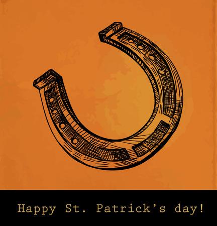 herradura: Tarjeta del día de San Patricio, herradura dibujado a mano en el fondo de color naranja con textura de papel viejo