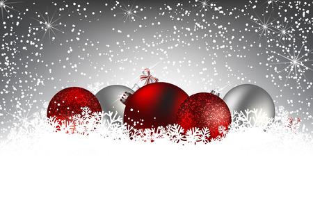 Tarjeta de Navidad. Adornos de Navidad en la nieve sobre fondo gris de invierno con la caída de nieve y luces. Espacio para el texto.