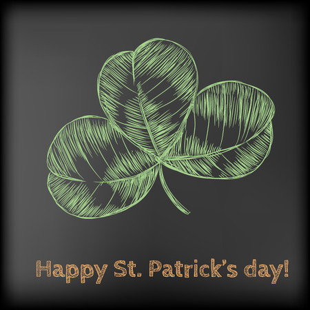 three leaf clover: Hand- drawn three leaf clover on chalkboard background. St.Patricks day design.