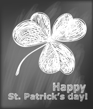 three leaf clover: St. Patrick day card. Hand- drawn three leaf clover and lettering  on  chalkboard background.