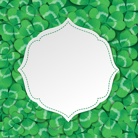 three leaf: St. Patrick day card. White label with space for text on background covered with many three leaf clovers.