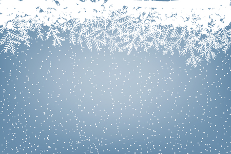 Winter background with falling snow and fir branches. Christmas card with space for text.