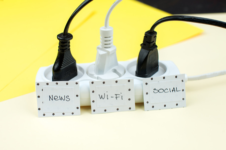 Trendy flat lay minimal concept, unplugged cord with word work, media