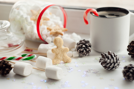 Beautiful Christmas background cookies, new year sweets and cup of coffee on white background