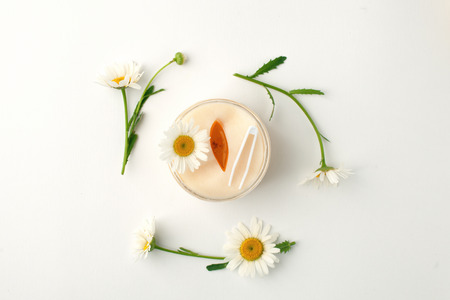 Plant-based beauty products. Eyes pads with herbal extract, camomile flowers, concept of organic plant cosmetics product.
