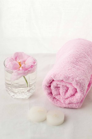 Beautiful composition of spa treatment on white tissue background, monochrome pastel concept