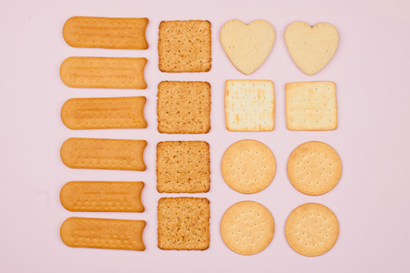 The food is laid out geometrically correctly, in rows. Biscuits of different shapes, flour products