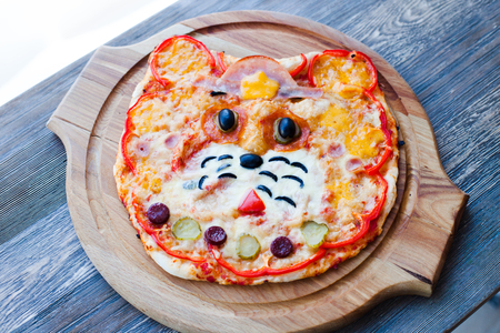 children's funny pizza in the form of a cat's face - Italian cuisine, children's menu