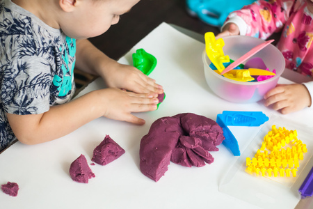 Art therapy for anxious children, cure for stress free, play colorful dough with vary shape of mold, for enhance imagination