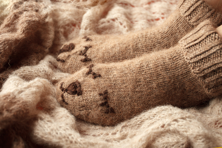 Clothes for the cold seasons. Knitted clothing. Socks with ornament. Fall autumn winter flu hipster closeup