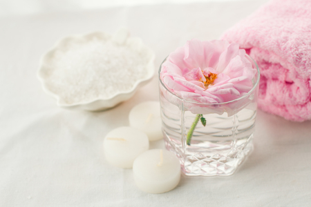 Romantic composition with candles and flowers. The concept of Spa, cosmetic, procedure, treatment. aroma theme