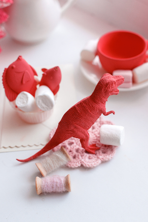 Modern surreal tea party with living coral color toy, sweetness, wonderland morning on windowsiil