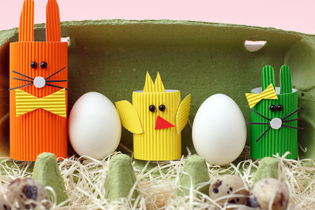 Easter spring decorative composition with homemade easter paper craft funny rabbit, chickens and quail eggs