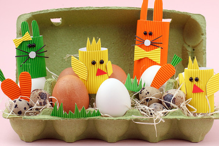 Easter eggs and cute bunny and chickens in basket. Festive decoration. Happy Easter closeup Stock Photo