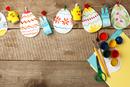 easter eggs garland on wooden vintage rustic background, copy space, flat lay Stock Photo