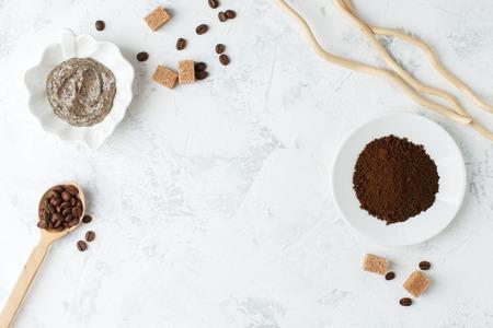 Spa treatment. Coffee organic sugar scrub on white background top view copyspace, nutrition wellness body scin care concept