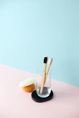 Zero waste bathroom. Natural products sponge, Konjac, washcloth, soap, glass tumbler, toothbrush on modern 3d rendering imitation 版權商用圖片