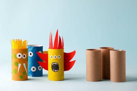 Monsters from toilet tube for halloween decor. A terrible craft. School and kindergarten. Handcraft creative idea Banco de Imagens
