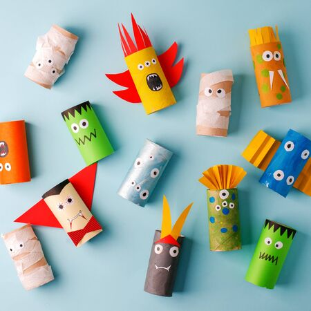 Halloween and decoration concept - monsters from toilet paper roll tube. Simple diy creative idea. Eco-friendly reuse recycle decor, kindergarten paper craft