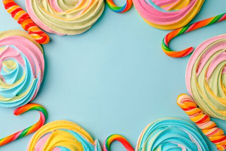 Frame made with tasty sugar candies on color background, top view. Space for text, party, candy bar, childhood, birthday concept
