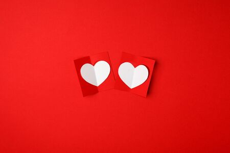 Red white paper hearts on a red background. Empty place for copy space for text. mock-up, minimal concept of romance winter february holiday. saint Valentine day
