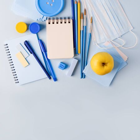 School Quarantine global pandemic corona virus covid-19 to school, tools, notebook medicine mask pencil on blue background, stylish banner flyer, preventive measure