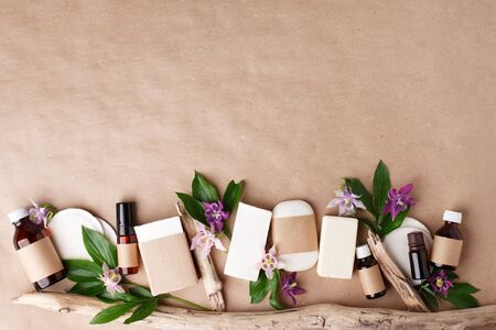 Natural organic cosmetic skincare packaging mock up with leaves and flowers, Eco-friendly bio science beauty concept. Bottle for branding and label, wellbeing self-care focuse