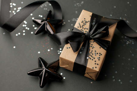Christmas gifts, presents, ornaments on black holiday background.
