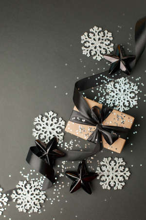 Beautiful christmas black silver decorative toys star snowflakes on dark black background.