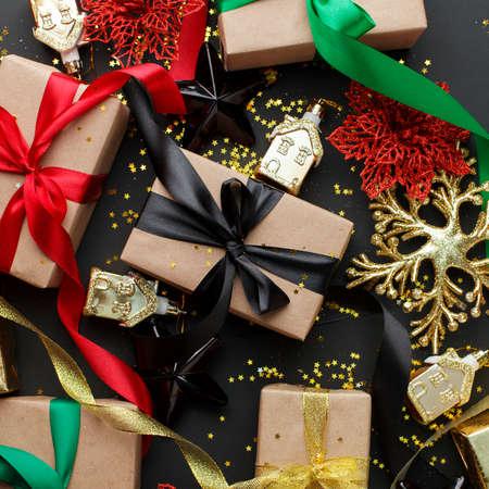 Set of gift box, christmas red balls and black stars on dark background