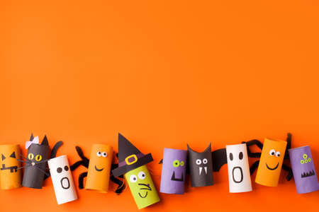 Set of handmade toys for Halloween party. Paper crafts, easy DIY. Handcraft creative idea from toilet tube for preschool, daycare kindergarten art class, recycle reuse, copy space