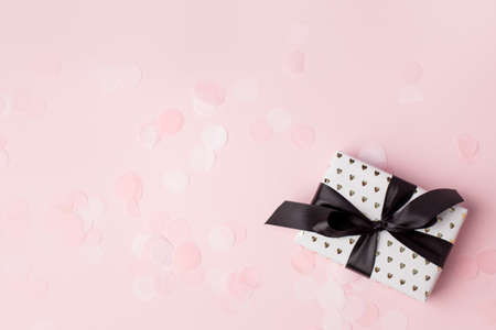 Gift or present box on pastel pink background, Credit card reward point, cash back, bonus for special member concept. Business and financial shopping sale promotion, season holiday sale concept