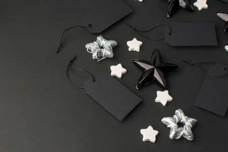 Black Friday blank template tag label with silver stars decorations, celebration mock up with copy space, seasonal holiday New Year, Merry Christmas sale - concept of shopping, flyer, voucher