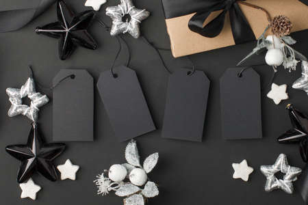 New Year 20202, Christmas Holiday seasonal sale - tags with copy space, gift box and decorations on balck background. Monochrome stylish luxury concept, banner, voucher for shopping