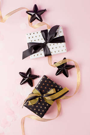 Gift or present boxes on pastel pink background, Credit card reward point, cash back, bonus for special member concept. Business and financial shopping sale promotion, season holiday sale concept