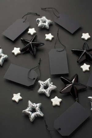 New Year 20202, Christmas Holiday seasonal sale - tags with copy space and stars decorations on balck background. Monochrome stylish luxury concept, banner, voucher for shopping Banco de Imagens