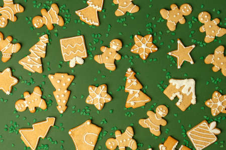 Winter Holiday pattern - set of gingerbread on natural shades of green background - man in mask, house, xmas tree, stars, Happy New Year 2021, Merry Christmas background, trendy concept