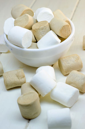 pale color: marshmallow white and coffee colors on a white background Stock Photo